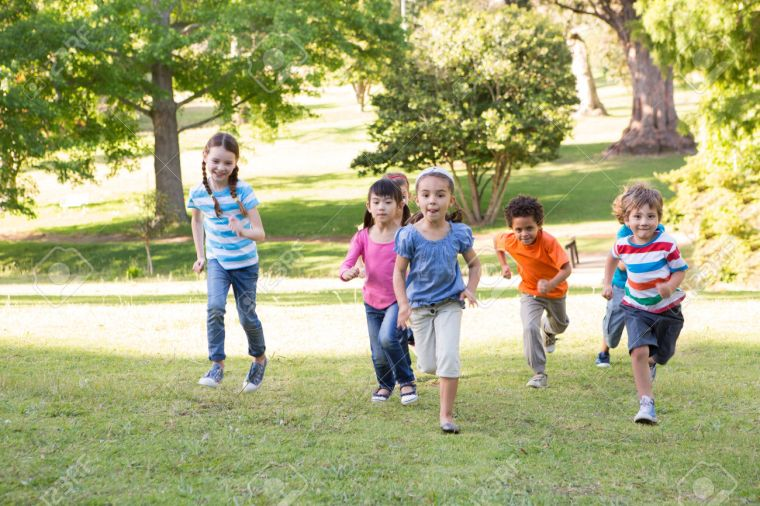 46211978-Children-racing-in-the-park-on-a-sunny-day-Stock-Photo-playing-child-park.jpg