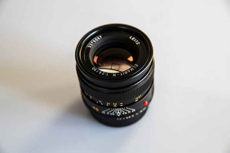 photo of black zoom lens on white surface