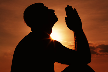 Praying man silhoutte
